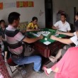 Stock Video: Chinese adult playing mahjong domino