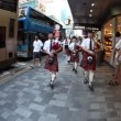 Bagpipes in Nathan&#039;s Rd. Hong Kong - Stock Photo