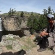 Mongolian man watching waterfall in The Gobi Desert in Mongolia, fisheye — Stock Video