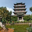 Time lapse of Pagoda in old town Lijiang in Yunnan province, China - Stock Photo