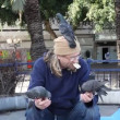 Man feeds pigeons. — Stock Video