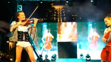 Band of young sexy girls playing string instruments — Stock Video