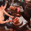 Stock Video: Chinese cook chops up dog meat for consumption