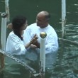 Baptism of pilgrims in the Jordan River Holy Land Israel — Stock Video