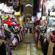 Tourists and locals visit bazaar market street old Jerusalem - Stock Photo