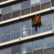 Stock Video: Firefighter rescues casualty by rappelling from Tel Aviv Municipality building