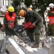 Stock Video: Soldiers cut through steel during earthquake drill