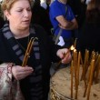 Stock Video: Pilgrim light candles at baptismal site in JordRiver Holy Land Israel