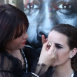 Stock Video: Makeup in street before Carnival