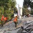 Soldiers search for earthquake casualties digging through the rubble - Stock Photo