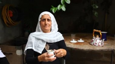 A Druze old senior woman in Isfiya drinks Yerba Mate — Stock Video