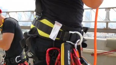 Firefighter rappelling gear — Stock Video