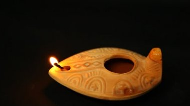 Olive oil clay ancient lantern lamp - flame in the wind — Stock Video