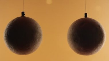 Science project: balls attracted when air passes between them — Stock Video