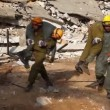Stock Video: Rescue soldiers carry on stretcher earthquake victim to hospital