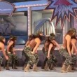 Teen girls dance like soldiers during Social Integration of the Carnival — Stock Video