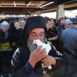 Stock Video: Greek Orthodox priest holds pigeon of peace, Holy Land Israel