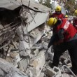 Firefighters search for earthquake casualties digging through rubble — Stock Video #23080282