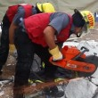 Stock Video: Firefighter cuts steel to rescue earthquake casualty victims