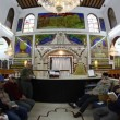 Stock Video: Believers pray afternoon prayer in Bushaief Synagogue