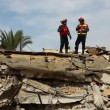 Stock Video: Firefighters search for earthquake casualties digging through rubble