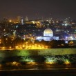 Stock Video: Skyline of Jerusalem Dome of Rock at night time lapse pan