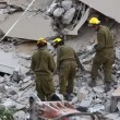 Stock Video: Soldiers search for earthquake casualties digging through rubble