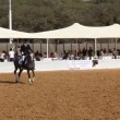 Rider demonstrates Old English riding style on his fine Arabian horse - Stock Photo