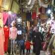 Tourists and locals visit bazaar market street old Jerusalem — Stock Video