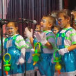 Kids with pacifier costume sing during the Murga competition of the carnival - Stock Photo