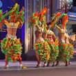 Carnival time! Happy people dance with costumes all day and night - Stock Photo