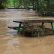 Picnic benches under water in flooded area — Stock Video