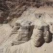 Qumran caves where Dead Sea Scrolls were found - Stock Photo