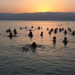Float in the dead sea during sunrise — Stock Video