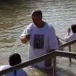 Stock Video: Pilgrims baptise in JordRiver Holy Land Israel