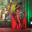 Dancing and performing in the Adult Costume Competition of the Carnival - Stock Photo
