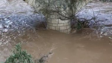 Brown floodwater bridge after the rain — Stock Video