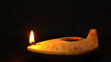 Extinguishing olive oil clay ancient lantern lamp - flame in motion — Stock Video