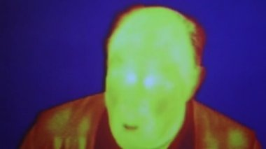 Infrared radiation thermal imaging camera of a funny bald man and woman — Stock Video