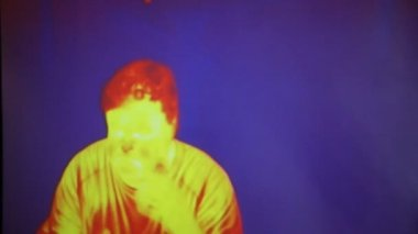 Infrared radiation thermal imaging camera of a man — Stock Video