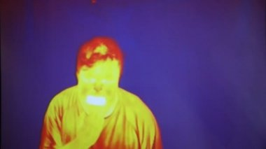 Funny face infrared radiation thermal imaging camera of a man — Stock Video