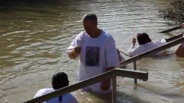 Pilgrims baptise in the Jordan River Holy Land Israel — Stock Video