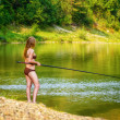 Beautiful fishing young woman — Stock Photo