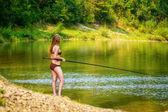 Beautiful fishing young woman — Stock Photo