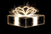 Packed gift by sparkler style with freeze light. — Stock Photo