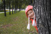 Young woman in red jackey looks out — Foto de Stock