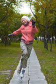 Yound woman in red jacket jumps and have a fun — Foto de Stock