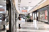 Interior of modern mall with some people in it — Stock Photo