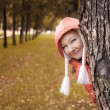 Young woman in red jackey looks out — Stock Photo