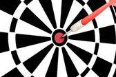 Red dart hitting a target — Stock Photo